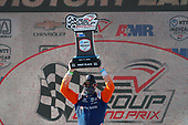 #9: Scott Dixon, Chip Ganassi Racing Honda celebrates on the podium