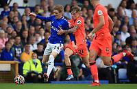 25th September 2021; Goodison Park, Liverpool, England; Premier League football, Everton versus Norwich; Anthony Gordon of Everton takes on Brandon Williams of Norwich City