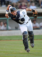 Catcher Larry Gonzalez (23) of the Pulaski Mariners in a game against the Danville Braves on July 19, 2010, at Calfee Park in Pulaski, Va. Photo by: Tom Priddy/Four Seam Images