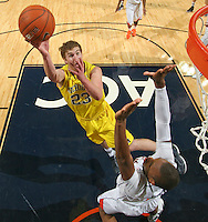 CHARLOTTESVILLE, VA- NOVEMBER 29: Evan Smotrycz #23 of the Michigan Wolverines shoots the ball during the game on November 29, 2011 at the John Paul Jones Arena in Charlottesville, Virginia. Virginia defeated Michigan 70-58. (Photo by Andrew Shurtleff/Getty Images) *** Local Caption *** Evan Smotrycz