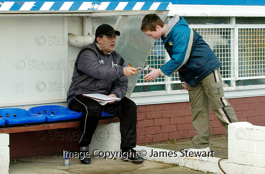 05/02/2005  Copyright Pic : James Stewart.File Name : jspa01_qots_v_dundee_utd.DUNDEE UTD MANAGER IAN MCCALL SIGNS AUTOGRAPHS AS HE TRIES TO WORK OUT HIS TEAM'S TACTICS IN THE DUG OUT AN HOUR BEFORE THE START OF THE SCOTTISH CUP 4TH ROUND CLASH AGAINST QUEEN OF THE SOUTH...Payments to :.James Stewart Photo Agency 19 Carronlea Drive, Falkirk. FK2 8DN      Vat Reg No. 607 6932 25.Office     : +44 (0)1324 570906     .Mobile   : +44 (0)7721 416997.Fax         : +44 (0)1324 570906.E-mail  :  jim@jspa.co.uk.If you require further information then contact Jim Stewart on any of the numbers above.........A