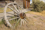 Skinner's Saloon in the background was a popular gathering place for Henry Plummer and his road agents before Plummer's final demise by hanging in Bannack MT. A broken wagon wheel sits in the foreground and the saloon is in the background.