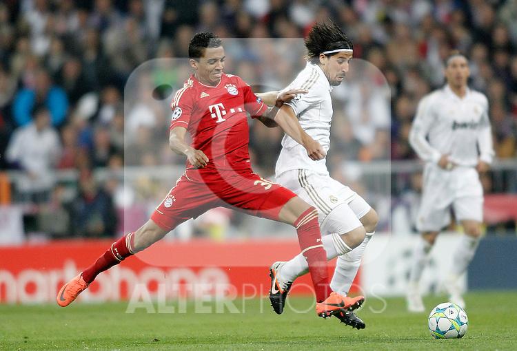 Real Madrid's Sami Khedira against Bayern Munich's Luiz Gustavo during UEFA Champions League match. April 25, 2012. (ALTERPHOTOS/Alvaro Hernandez)