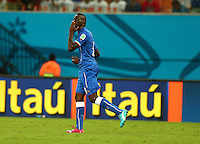 Mario Balotelli of Italy celebrates scoring his goal to make the score 2-1 by blowing a kiss to his fiance Fanny Neguesha in the crowd