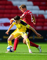 Lincoln City's James Jones battles with Oxford United's Liam Kelly<br /> <br /> Photographer Andrew Vaughan/CameraSport<br /> <br /> The EFL Sky Bet League One - Saturday 12th September  2020 - Lincoln City v Oxford United - LNER Stadium - Lincoln<br /> <br /> World Copyright © 2020 CameraSport. All rights reserved. 43 Linden Ave. Countesthorpe. Leicester. England. LE8 5PG - Tel: +44 (0) 116 277 4147 - admin@camerasport.com - www.camerasport.com - Lincoln City v Oxford United