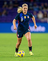 ORLANDO, FL - FEBRUARY 24: Lindsey Horan #9 of the USWNT dribbles during a game between Argentina and USWNT at Exploria Stadium on February 24, 2021 in Orlando, Florida.