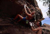 Climbing ranks high with the non-mechanized crowd. Noah Bigwood spots Lisa Hathaway while they boulder at the Crack House near Moab, Utah. Lisa is an avid climber, trainer and guide.  Noah has been climbing for nearly thirty years and is a recognized figure in the national and international climbing communities.