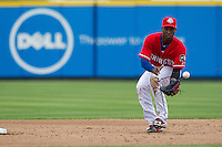 Round Rock Express second baseman Jurickson Profar #10 fields a ground ball against the Omaha Storm Chasers in the Pacific Coast League baseball game on April 7, 2013 at the Dell Diamond in Round Rock, Texas. Omaha beat Round Rock 5-2, handing the Express their first loss of the season. (Andrew Woolley/Four Seam Images).
