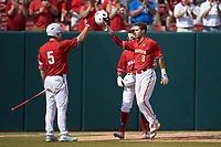 Will Wilson (8) of the North Carolina State Wolfpack celebrates with teammate Patrick Bailey (5) after hitting a home run against the Army Black Knights at Doak Field at Dail Park on June 3, 2018 in Raleigh, North Carolina. The Wolfpack defeated the Black Knights 11-1. (Brian Westerholt/Four Seam Images)