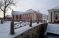 The bridge over the frozen stream leads to the red and white painted Neoclassical stables