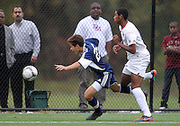 HYATTSVILLE, MD - OCTOBER 26, 2012:  Julian Dove (17) of DeMatha Catholic High School chases after Chris Fleisher (25) of St. Albans during a match at Heurich Field in Hyattsville, MD. on October 26. DeMatha won 2-0.