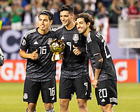 CHICAGO, IL - JULY 7: Raul Jimenez #9 poses with the golden ball award with Erick Gutierrez #16 and Rodolfo Pizarro #20 during a game between Mexico and USMNT at Soldier Field on July 7, 2019 in Chicago, Illinois.