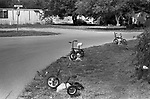 Suburban street in  a small town America, unusual unique garden decoration using children tricycles 1999 Cico Texas USA 1990s