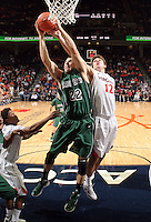 CHARLOTTESVILLE, VA- NOVEMBER 26:  Daniel Turner #22 of the Green Bay Phoenix reaches for the rebound with Joe Harris #12 of the Virginia Cavaliers during the game on November 26, 2011 at the John Paul Jones Arena in Charlottesville, Virginia. Virginia defeated Green Bay 68-42. (Photo by Andrew Shurtleff/Getty Images) *** Local Caption *** Joe Harris;Daniel Turner