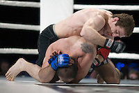 Moscow, Russia, 05/06/2010..Sergei Minasiyan tries to protect his head against blows from Murad Machaev during a mix-fight bout at Fight Nights, a new Moscow boxing tournament..
