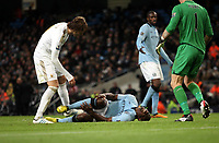 Barclays Premier League, Man City (blue) V Swansea City (white) Etihad Stadium, 27/10812<br /> Pictured: Micah Richards suffered a painful looking injury in the second half that saw him stretched off<br /> Picture by: Ben Wyeth / Athena Picture Agency
