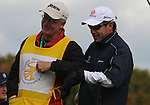 5 October 2008: Brian Davis' caddie nudges him in the chest after a joke during the final round at the Turning Stone Golf Championship in Verona, New York.
