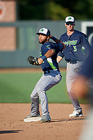 Vermont Lake Monsters second baseman Yerdel Vargas (2) throws to first base as shortstop Logan Davidson (3) backs up the play during a NY-Penn League game against the Aberdeen IronBirds on August 18, 2019 at Leidos Field at Ripken Stadium in Aberdeen, Maryland.  Vermont defeated Aberdeen 6-5.  (Mike Janes/Four Seam Images)