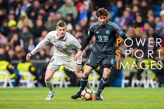 Esteban Felix Granero Molina (r) of Real Sociedad vies for the ball with Toni Kroos of Real Madrid during their La Liga match between Real Madrid and Real Sociedad at the Santiago Bernabeu Stadium on 29 January 2017 in Madrid, Spain. Photo by Diego Gonzalez Souto / Power Sport Images