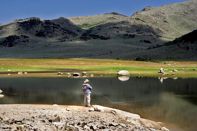 Fly fisherman on Onion Valley Reservoir. Nevada