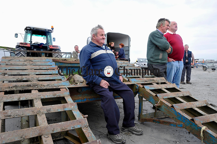 James Madigan Kilrush and Paddy Carey and Tony Mc Inerney of Doonbeg look on at the Leon Currach Regatta at Seafield, Quilty. Photograph by John Kelly.