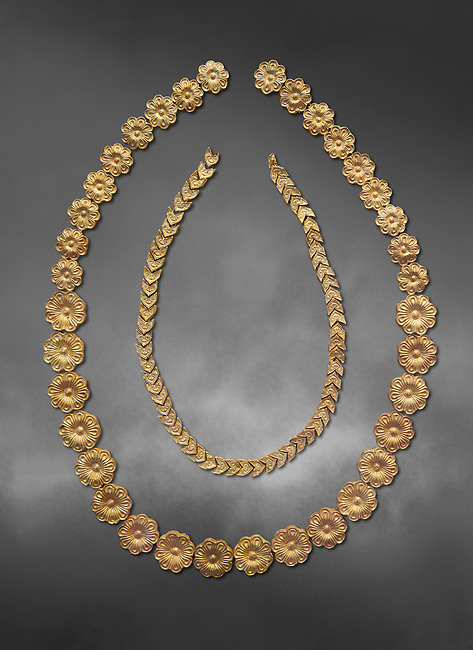 Mycenaean gold necklace from the Mycenaean cemetery of Midea tholos tomb , Dendra, Greece. National Archaeological Museum Athens. Grey art Background <br /> <br /> Inside mycenaean necklace has gold ivy leaf beads, Cat No 7354. The outer mycenaean necklace has rosette shaped gold beads, Cat No 7342. 15th-14th century BC.