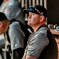 26 September 2018: Miami Marlins Catching Coach Brian Schneider sits in the dugout during a game against the Washington Nationals at Nationals Park in Washington, DC. The Nationals defeated the visiting Marlins 9-3, closing out Washington's 2018 home season. Mandatory Credit: Ed Wolfstein Photo *** RAW (NEF) Image File Available ***