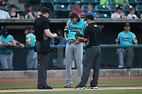 Llamas de Hickory starting pitcher Cole Ragans (31) has his belt checked for any foreign substances by umpire Mitch Leikam (left) and Josh Gilreath (right) between innings of the game against the Winston-Salem Rayados at Truist Stadium on July 6, 2021 in Winston-Salem, North Carolina. (Brian Westerholt/Four Seam Images)