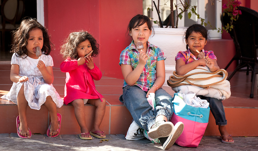 Hot days and cold ice cream on the street corner – their content faces say it all!