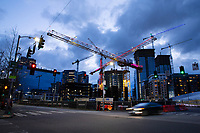 SEATTLE, WA - APRIL 2: Tower cranes crisscross the sky on April 2, 2020 in Seattle, Washington. Most commercial and residential construction sites are considered a nonessential activity and operations have stopped under the state's new stay-at-home order in an effort to slow the spread of coronavirus (COVID-19). (Photo by Karen Ducey/Getty Images)
