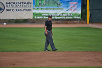 Umpire Luis Hernandez handles the calls on the bases during the Pioneer League game between the Ogden Raptors and the Missoula Osprey at Lindquist Field on July 20, 2015 in Ogden, Utah. Missoula defeated Ogden 10-6. (Stephen Smith/Four Seam Images)