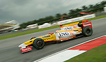 05 Apr 2009, Kuala Lumpur, Malaysia --- ING Renault F1 Team driver Fernando Alonso of Spain steers his car during the 2009 Fia Formula One Malasyan Grand Prix at the Sepang circuit near Kuala Lumpur. Photo by Victor Fraile --- Image by © Victor Fraile / The Power of Sport Images