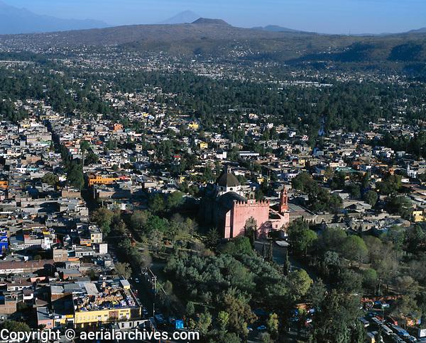 aerial photograph of the San Bernadino Church in the center of Xochimilco, greater Mexico City; the Guadalupe Mountains are visible in the background, left | fotografía aérea de la Iglesia de San Bernadino en el centro de Xochimilco, Ciudad de México
