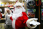WATERBURY CT. 22 December 2017-122217SV01-Mike Patrick, Republican American, sees what it feels like to transform into Santa at Arabesque on Bank Street in Waterbury Friday. Michael Rinaldi, owner dressed Mike.<br /> Steven Valenti Republican-American