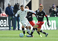 WASHINTON, DC - FEBRUARY 29: Washington, D.C. - February 29, 2020: Andre Shinyashiki #99 of the Colorado Rapids battles the ball with Julian Gressel  #31 of D.C. United and Russell Canouse #4 of D.C. United.  The Colorado Rapids defeated D.C. United 2-1 during their Major League Soccer (MLS)  match at Audi Field during a game between Colorado Rapids and D.C. United at Audi FIeld on February 29, 2020 in Washinton, DC.