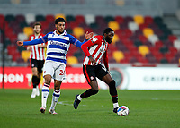 19th December 2020; Brentford Community Stadium, London, England; English Football League Championship Football, Brentford FC versus Reading; Josh Dasilva of Brentford is challenged by Josh Laurent of Reading