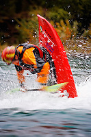 Andrew Jobe attempts an air loop in a whitewater kayak on the Kananaskis River, Kananaskis County, Alberta, Canada
