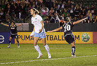 LA Sol's Camille Abily begins to celebrate her goal with teammate Han Duan. The LA Sol and the Red Stars of Chicago played to a 1-1 draw    at Home Depot Center stadium in Carson, California on Wednesday evening June 3, 2009.   .