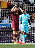 Pictured: Edin Dzeko of Manchester City holds his head in his hands after his shot goes wide.. Saturday 04 May 2013<br /> Re: Barclay's Premier League, Swansea City FC v Manchester City at the Liberty Stadium, south Wales.