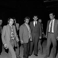 """Double crime d'Ondes. Les assassins keller et Horneich <br /> <br /> """"+ M. Dalas chef du SRPJ"""" 4 octobre 1972. Vue d'ensemble de 3/4 face de Marcellin Horneich, menoté et entouré des policiers chargés de l'enquête ; le suspect regarde en direction du photographe. Cliché pris le lendemain de l'arrestation des deux suspects Joseph Keller et Marcellin Horneich dans l'affaire du double meurtre d'Ondes. Observation: Dans la nuit du 29 au 30 août 1972, un couple de touristes anglais autostoppeurs, est assassiné à Ondes (José Clive Latter 23 ans et Joy Joffe 20 ans). Un mois après, les auteurs du crime sont interpelés : ils s'agit de Marcellin Horneich et son neveu Joseph Keller. Ils avouent leur crime le 4 octobre 1972. Après 4 ans d'instruction, ils sont condamnés à mort le 25 juin 1976 par la Cour d'Assises de la Haute-Garonne. Le 8 janvier 1977, ils sont tous les deux graciés par le Président Valéry Giscard d'Estaing."""