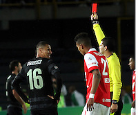BOGOTA -COLOMBIA, 16-NOVIEMBRE-2014. <br /> Ramiro Suarez arbitro central muestra la tarjeta  roja al jugador Luis Paez de Atletico Nacional  durante el encuentro contra  el Atletico Nacional  partido por los cuadrangulares semifinales 1 fecha  de la Liga Postobón II 2014 jugado en el estadio Nemesio Camacho El Campin de la ciudad de Bogota./ Ramiro Suarez center referee showing the red card to the player Luis Paez  Atletico Nacional during the match against Independiente Santa Fe Semifinal match by 1 runs from the date Postobón II League 2014 played at the stadium Nemesio Camacho El Campin in Bogota city.Photo / VizzorImage / Felipe Caicedo  / Staff