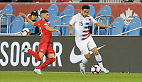 TORONTO, ON - OCTOBER 15: Cristian Roldan #15 of the United States moves past Jonathan Osorio #21 of Canada battle during a game between Canada and USMNT at BMO Field on October 15, 2019 in Toronto, Canada.