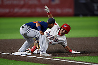 Connecticut Tigers third baseman Jose King (56) attempts to tag Jake Alu (9) sliding in safely during a NY-Penn League game against the Auburn Doubledays on July 12, 2019 at Falcon Park in Auburn, New York.  Auburn defeated Connecticut 7-5.  (Mike Janes/Four Seam Images)