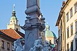 Slovenia, Ljubljana, Old Town or Staro Mesto, Mestni Trg, central square of oldest part of the city, Robba Fountain, Church of Saint Nicholas, street musicians, pedestrian friendly, car-free environment, Baroque architecture, Europe, European Union,