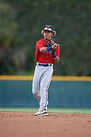 GCL Twins second baseman Jim Caceres (5) throws to first base during a Gulf Coast League game against the GCL Pirates on August 6, 2019 at Pirate City in Bradenton, Florida.  GCL Twins defeated the GCL Pirates 1-0 in the second game of a doubleheader.  (Mike Janes/Four Seam Images)