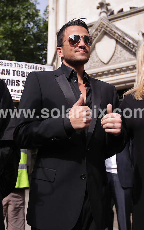 **ALL ROUND PICTURES FROM SOLARPIX.COM**.**NO UK NEWSPAPER PUBLICATION**.**UK MAGAZINE & SUPPLEMENT PUBLICATION ONLY** AND NO PUBLICATION IN AUSTRALIA, FRANCE, GERMANY, ITALY AND SCANDINAVIA** .Singer song writer Peter Andre arrives at the High Court, The Strand in London where a statement was read out in open court regarding Peter Andre's libel case against The Sunday People newspaper..London, UK. 31 July 2009 ..This pic: Peter Andre..JOB REF: 9649        SFE       DATE: 31.07.09.**MUST CREDIT SOLARPIX.COM OR DOUBLE FEE WILL BE CHARGED**.**MUST NOTIFY SOLARPIX OF ONLINE USAGE**.**CALL US ON: +34 952 811 768 or LOW RATE FROM UK 0844 617 7637**