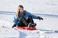 Pictured: A young woman on a sleigh at Storey Arms in the Brecon Beacons, Wales, UK. Monday 11 December 2017<br /> Re: Freezing temperatures, snow and ice has affected parts of the UK.