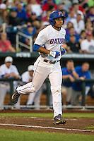 Richie Martin (12) of the Florida Gators runs during a game between the Miami Hurricanes and Florida Gators at TD Ameritrade Park on June 13, 2015 in Omaha, Nebraska. (Brace Hemmelgarn/Four Seam Images)