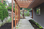 Totem in Entryway Garden.  Private garden professionally landscaped.