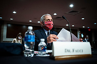 Anthony Fauci, director of the National Institute of Allergy and Infectious Diseases, wears a Washington Nationals protective mask while arriving to a Senate Health, Education, Labor and Pensions Committee hearing in Washington, D.C., U.S., on Tuesday, June 30, 2020. Top federal health officials are expected to discuss efforts to get back to work and school during the coronavirus pandemic. <br /> Credit: Al Drago/CNP/AdMedia